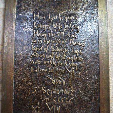 Plaque beside tomb